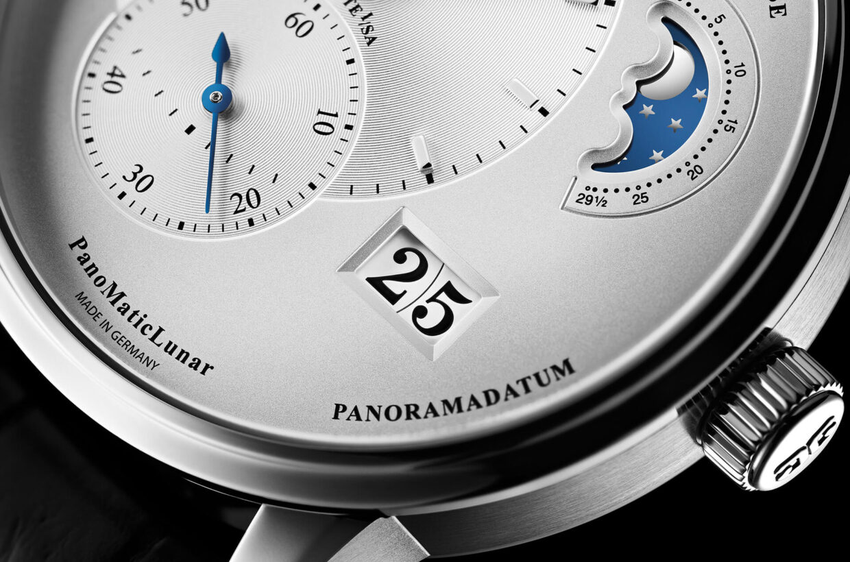 Silver-coloured dial Galvanic silver dial, vinyl pattern on off-centre displays, blued hands with Super-LumiNova inlays