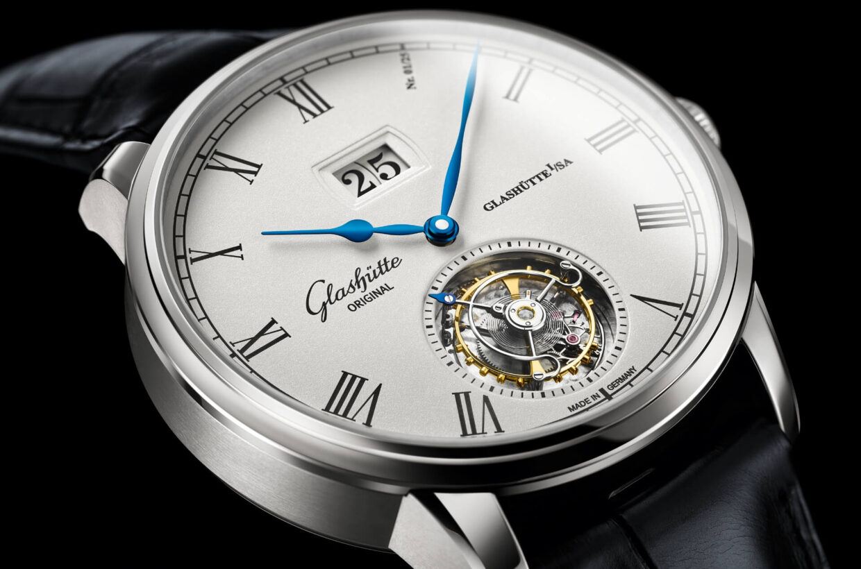 Silver dial Lacquered dial with fine silver graining, limited-edition number presented as Roman numeral 1 within the hour display, engraved numerals and railroad chapter ring with black inlays, Panorama Date, polished and blued hands