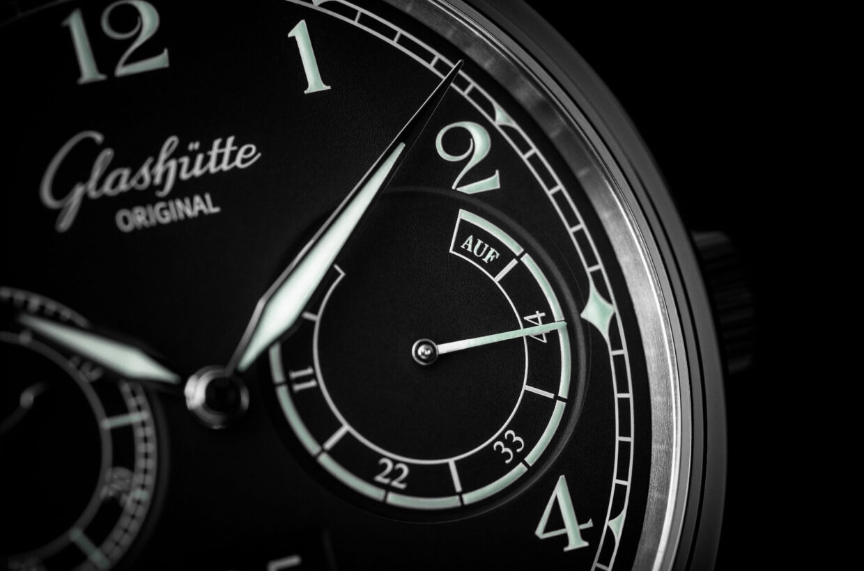 Black dial Matte black lacquered dial, sword-shaped white gold hands, balanced displays for small seconds and power reserve, large Arabic numerals in vintage typeface