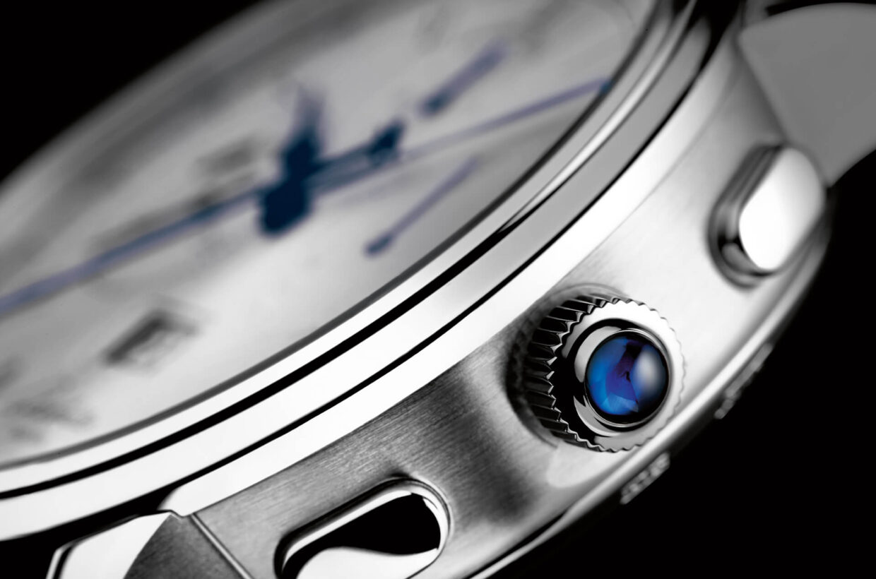 Platinum case Polished/satin-brushed case in platinum with sapphire crystal case back, platinum crown with blue sapphire cabochon