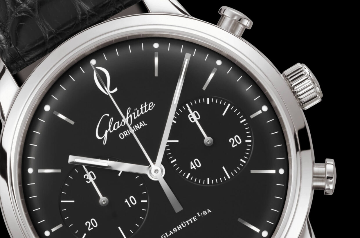 Black dial Domed black dial with incised hour indexes, white Arabic numerals and a finely drawn white minute scale with luminous dots