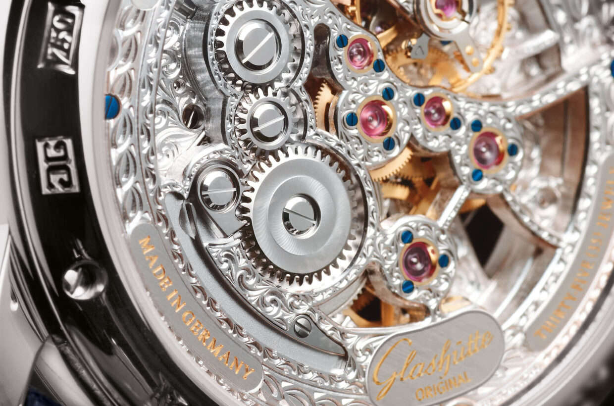 Love of detail The signature features of the Glashütte art of watchmaking, such as the winding wheels with double sunburst decoration, hand-engraved plates and the splendidly decorated cock of the swan-neck fine adjustment, are a testament to precision and exceptional love of detail.
