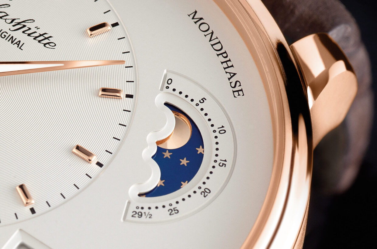 Gold-coloured moon Moon phase display with gold-coloured moon on galvanic blue starry sky